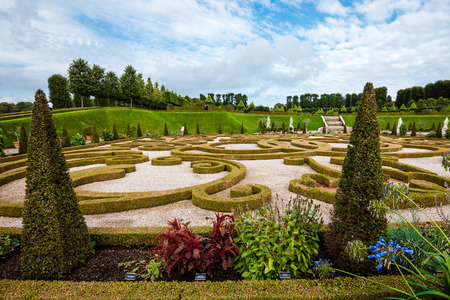 danish: Hillerod, Denmark - September, 24th, 2015. Royal park near Frederiksborg castle. Baroque garden with green trees, hedge and blossom flowers. Editorial