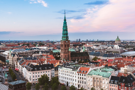 spiel: Panoramic view of evening Copenhagen streets and house roofs. Denmark capital Copenhagen old town top panoramic view. Spiel of Nikolaj Church and Amalienborg dome.