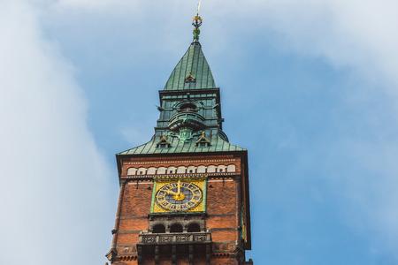 spiel: City hall tower spiel and golden clocks in Copenhagen, Denmark.