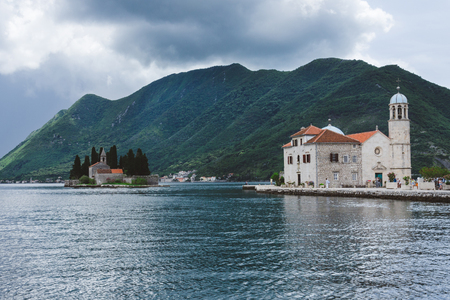 Our Lady Of The Rocks and Saint George islets near Perast on Kotor Bay. Saint George Benedictian monastery and Roman Catholic Church of Our Lady Of the Rocks are situated on the islands.