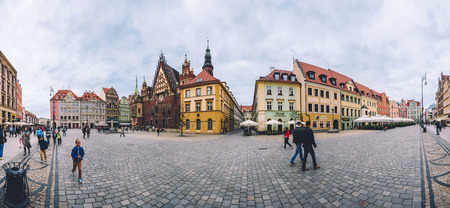 the old town hall: Wroclaw, Silesia, Poland - September, 20th, 2016. Wroclaw Old Town panorama with Market Square Rynek, Wroclaw Town Hall, traditional colorful houses, tourist walkway and pavement square. Editorial