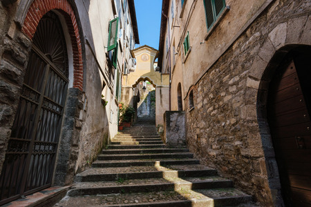 archways: Narrow streets of authentic Bellano fishing village, situated on Como Lake shore. Traditional italian houses, stone steps and arcway  in small town Bellano, Lombardy, Italy.