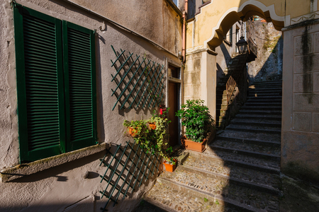 June 13th, 2017 - Lombardy, Italy. Narrow streets of authentic Bellano fishing village, situated on Como Lake shore. Traditional italian houses, stone steps and arcway  in small town Bellano.