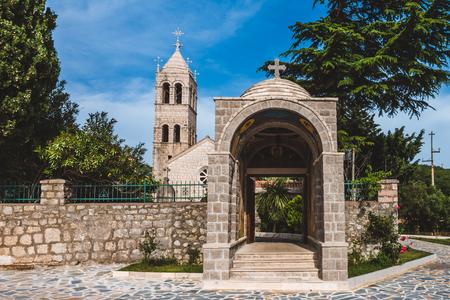 katun: Rezevici abbey is situated between Budva and Petrovac, Montenegro.Stone belfry and facade of The Serbian Orthodox Rezevici Monastery located in Katun Rezevici village near Perazica Do.