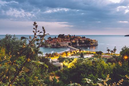 stephen: Sveti Stefan island - popular tourist attraction near Budva, Montenegro. Evening view of Adriatic sea coast and St. Stefan luxury fortificated village by lights.