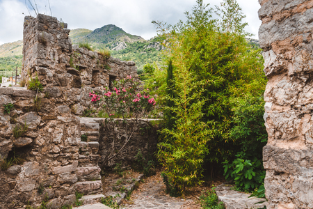 Ancient stone ruins and fortress wall in Old Bar town, Montenegro. Stari Bar - ruined medieval city on Adriatic coast, Unesco World Heritage Site. Stock Photo