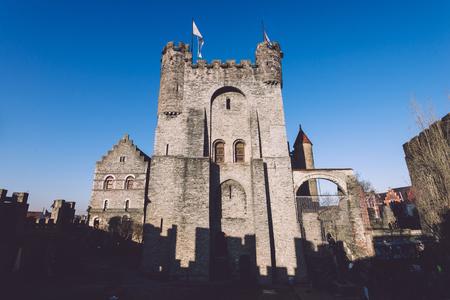 Ghent, Flanders, Belgium - December 30th, 2016. Gravensteen - historical medieval castle in flemish capital Gent. Castle of Counts stronghold by golde hour.