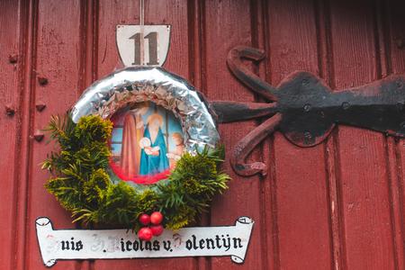 December, 29th, 2016 - Ghent, East Flanders, Belgium. Christmas wreath with Bible scene  hanging on door in Gent.