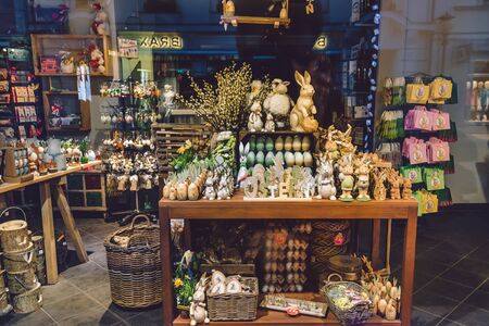April, 17th, 2017 - Potsdam, Brandenburg, Germany. Traditional festive Easter handmade decorations, such as straw rabbit, eggs, toys and flower in souvenir shop during Easter celebration in Potsdam.