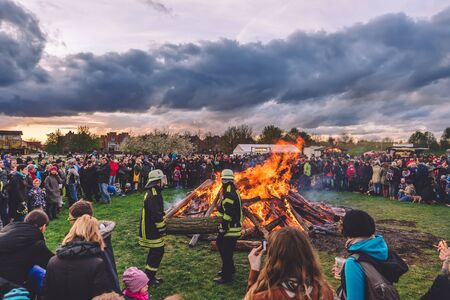 April, 14th, 2017 - Potsdam, Brandenburg, Germany. Traditional festive Easter bonfire in Volkspark public park during Easter holidays in Potsdam. Also known as Osterfeuer celebration. Publikacyjne
