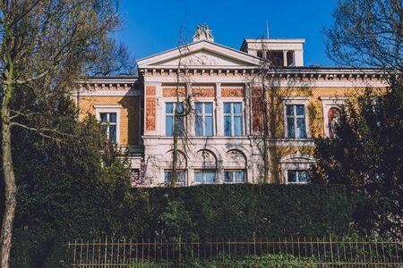 April, 9th, 2017 - Potsdam, Brandenburg, Germany. Family mansion building . Reach german villa or victorian manor in Potsdam by spring sunny day.