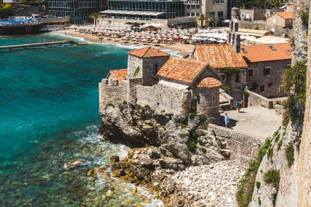 May, 30th, 2016 - Budva, Montenegro. Budva Old town beach and Citadele stone fortress with stone barracks and walls. Adriatic coast view. 新聞圖片
