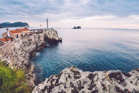 Coast venetian fortress Castello in Petrovac village, Montenegro. Montenegrin landscape with popular tourist attraction in Petrovac and Adriatic sea by evening.