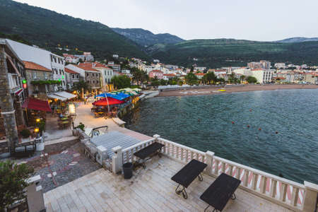 Petrovac, Montenegro - May 28th, 2016.  City lights, restaurants, marina and evening promenade at panoramic view of Petrovac - touristic town on Adriatic riviera.