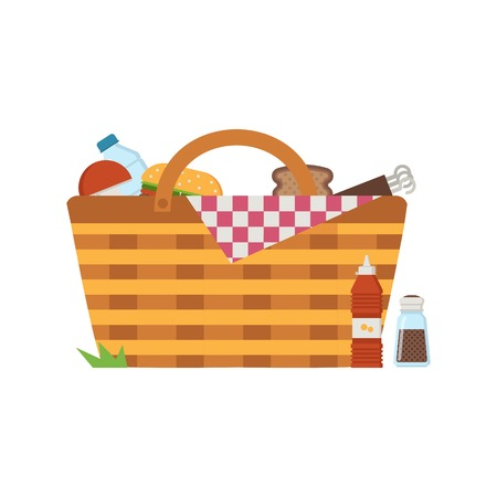 Wicker picnic basket with food. Opened food hamper with blanket for summer picnic.