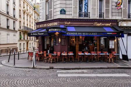 Paris, France - August 10, 2017. Typical Paris street with french restaurant Le Relais Gascon with summer terrace. View from the street, no people. Editorial