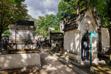 Paris, France - August 10, 2017. Tombs and monuments at old Montmartre cemetery which opened in 19th century and contains graves of many artists and famous people.