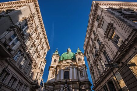 Vienna, Austria - December 24, 2017. St. Peters Church or Peterskirche is famous Baroque church and popular viennese landmark. Roman Catholic parish church with dome and chapels by sunny day.
