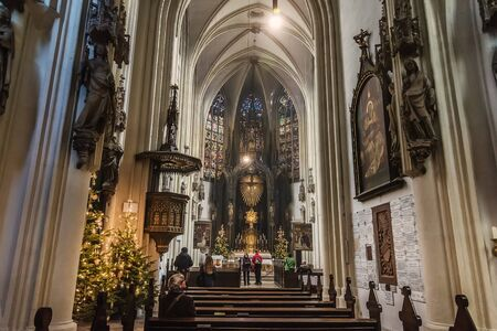 Vienna, Austria - December 31, 2017. Interior of Maria am Gestade or Church of Our Lady of the Riverbank with Christmas decoration. One of the oldest viennese churches of gothic architecture. Redakční