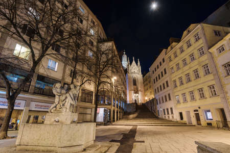 Vienna, Austria - December 29, 2017. View of Maria am Gestade (Mary at the Shore) oldest gothic viennese church illuminated at night with no people.