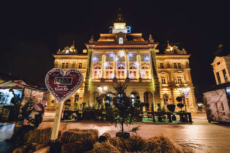 Novi Sad, Vojvodina, Serbia - December 17th, 2017. Novi Sad City Hall on Freedom square with Christmas market, holiday lights and decorations during Novosadski Winter Fest.