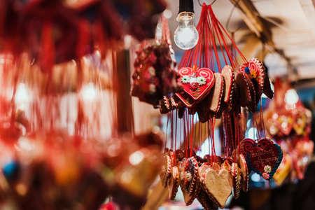 Novi Sad, Vojvodina, Serbia - December 17th, 2017. Traditional gingerbread hearts at serbian Novi Sad Christmas Market. Close view of Xmas fair kiosk selling sweets.