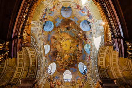Vienna, Austria - December 24, 2017. Ceiling paintings in State Hall of Austrian National Library - old baroque library of Hapsburg empire in Hofburg Palace. Fresco in the cupola depicts apotheosis.