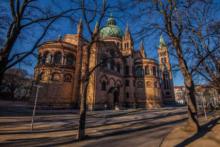 Vienna, Austria - December 25, 2017. St. Anthony of Padua Church built in Byzantine or Romanesque Revival architecture style. Facade of brick catholic church with green copper roof in Antonspark.