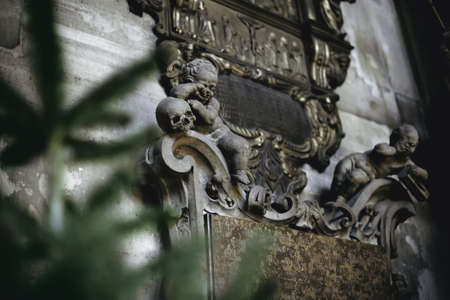 Vienna, Austria - December 30, 2017. Interior details of St. Stephens Cathedral. Inner gravestone with decorative bas-relief and statues depicts crying angels and skulls, as life and death symbols.
