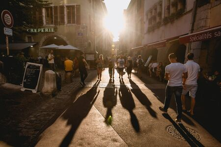 Long Shadows of People Walking at Sunset
