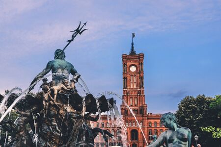Statues of Neptune Fountain and Berlin Rathaus