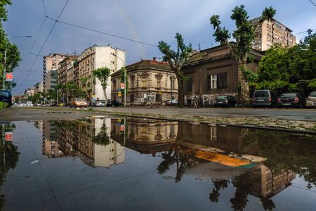 Belgrade Street Reflected in Water after Rain