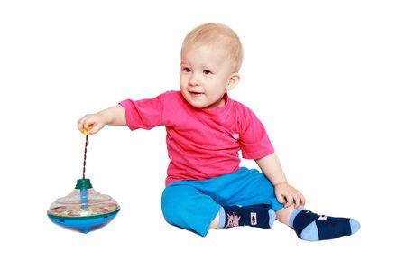 perinola: Chico con juguete en desarrollo-whirligig. La emoci�n y el placer de jugar