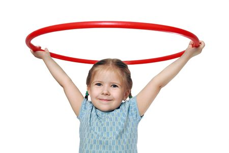The girl is engaged in art gymnastics. Exercise with a hoop.  photo