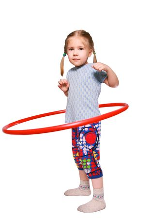 twists:  The girl is engaged in art gymnastics. Exercise with a hoop.  Stock Photo