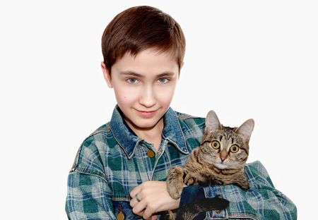 Friendship with a pet-a smiling boy with a cat on shoulder 스톡 콘텐츠