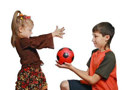 Children, the brother and the sister play with a ball