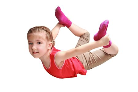 The girl carries out gymnastic exercise on the extension of muscles