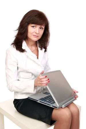 opens: The beautiful woman opens laptop. The beginning of work