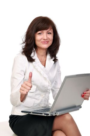 A smiling beautiful woman shows gesture success  Stock Photo