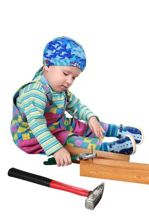 borrowed: The two-year-old boy with pleasure plays with tools, imitates adults at work  Stock Photo