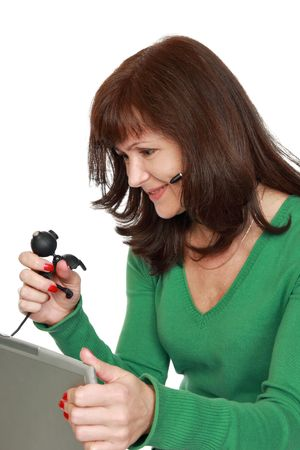communicates: The woman communicates through a web-cam by means of the Internet Stock Photo