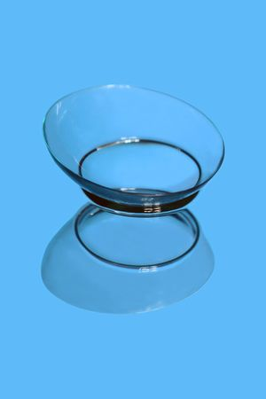 hyperopia: Soft contact lens on the reflecting surface  Stock Photo