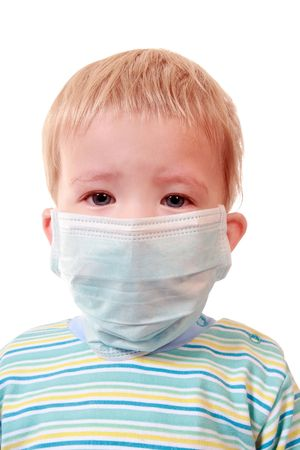 The boy uses a means of individual protection against infection   photo