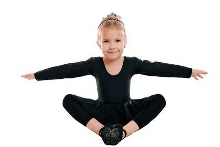 Emotional beautiful girl engaged in artistic gymnastics