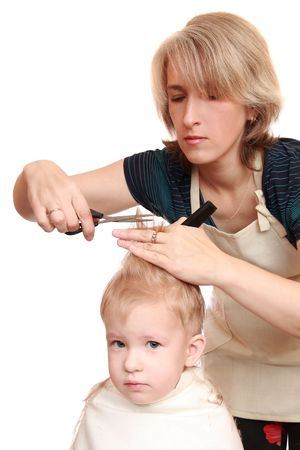 Mother trim 2.5-year-old son  Stock Photo