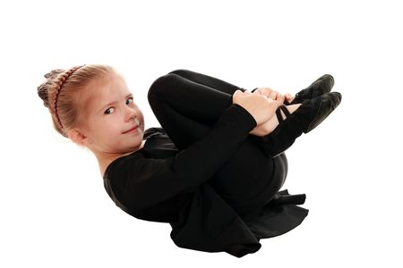 Girl performs gymnastic exercise   photo