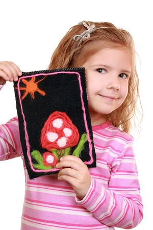 Girl with a homemade printed picture of felt