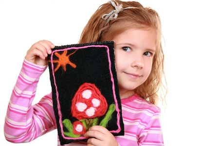 Girl with a homemade  picture of felt