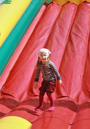 Girl playing on inflatable attractions photo